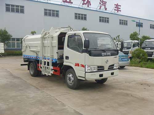 华通牌HCQ5075ZDJE5型侧装挂桶压缩式对接垃圾车