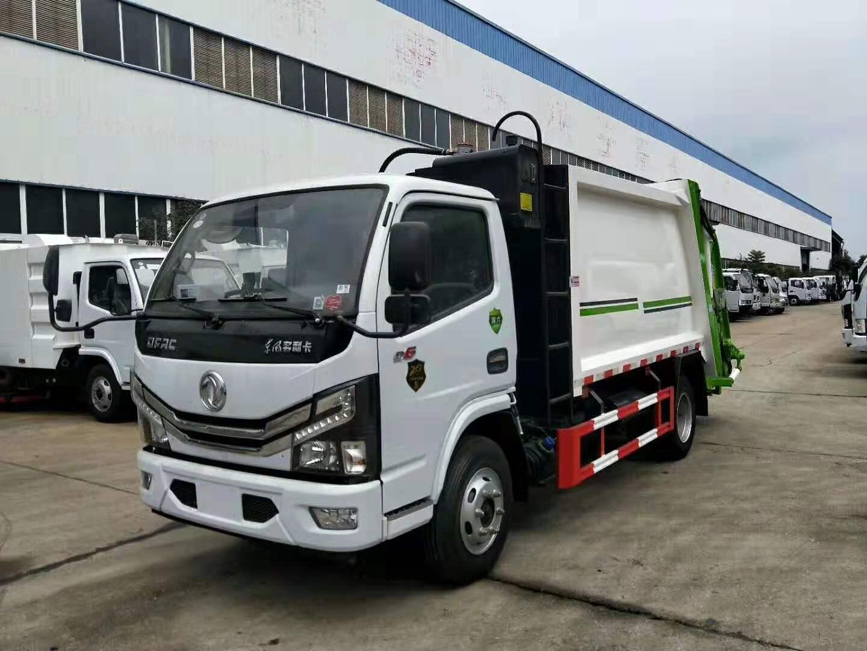 华通牌HCQ5075ZYSE6型压缩式垃圾车 国六东风多利卡福瑞卡6立方挂桶垃圾清运车