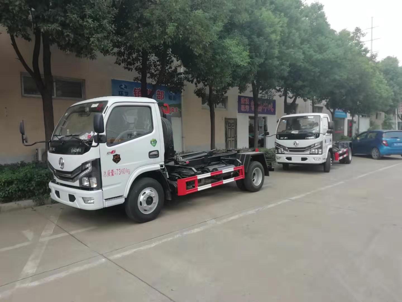国六东风蓝牌自卸式垃圾车,车厢可卸式垃圾车,勾臂式垃圾车